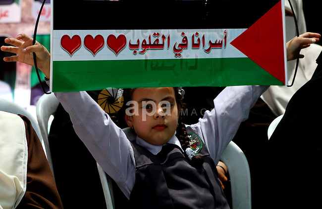 """A Palestinian girl attends a rally in Gaza City, to show solidarity with Palestinian prisoners held in Israeli jails on May 7, 2012. At least 1,550 Palestinian prisoners are refusing food in Israeli jails in a protest against their so-called """"administrative detention"""". Photo by Ashraf Amra"""