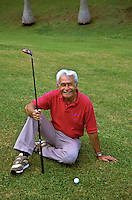 Senior Hawaiian man with golf club; Pali Golf Course, Windward Oahu