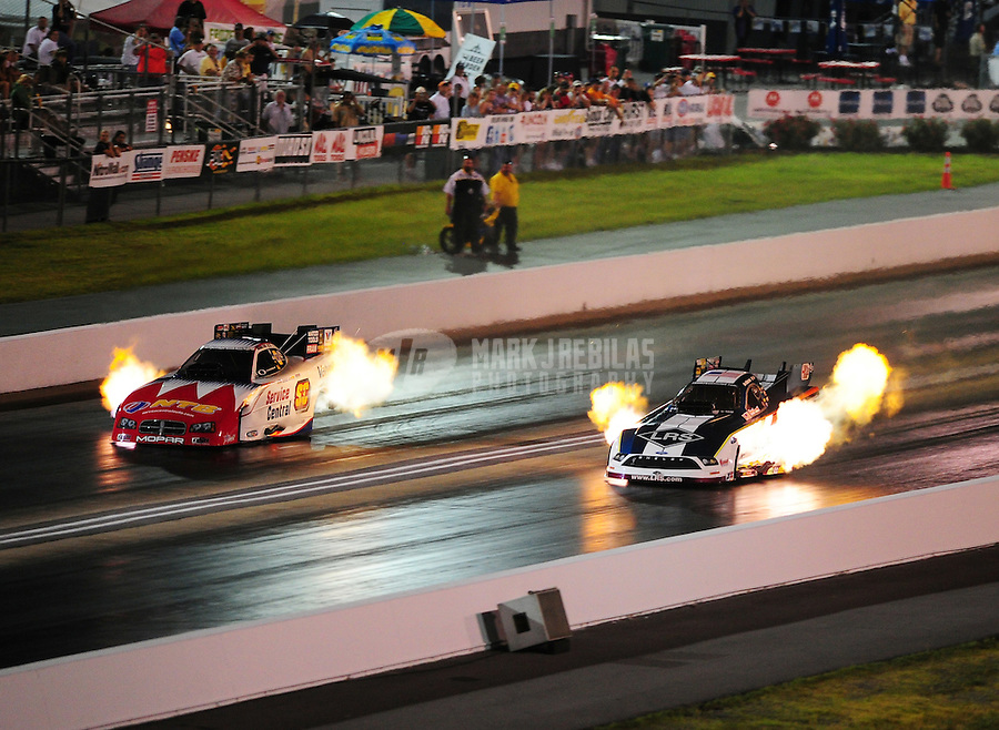 Jun. 17, 2011; Bristol, TN, USA: NHRA funny car driver Tim Wilkerson (right) alongside Johnny Gray during qualifying for the Thunder Valley Nationals at Bristol Dragway. Mandatory Credit: Mark J. Rebilas-