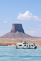Houseboat backed by dester tower on lake Powell