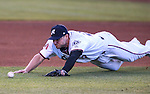 Reno Aces' Jamie Romak dives for a ground ball in a game against the Albuquerque Isotopes in Reno, Nev., on Saturday, April 18, 2015. The Isotopes won 9-4. <br /> Photo by Cathleen Allison