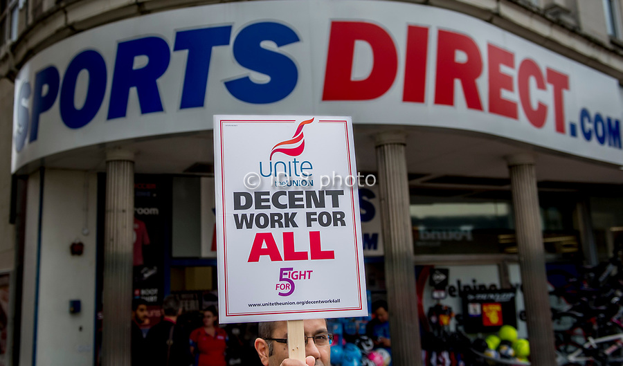 "Unite union members, demonstrate outside the shop of Sports Direct in Derby city centre. Unite the Union are demanding an end to what they call ""Victorian"" work practices at the company. The protest is part of a national day of action outside Sports Direct stores across the UK organized by the union."