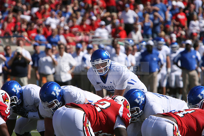 UK's Mike Hartline settles for the next play against the University of Louisville at Papa John's Cardinal Stadium on Saturday, Sept. 4, 2010. Photo by Scott Hannigan | Staff