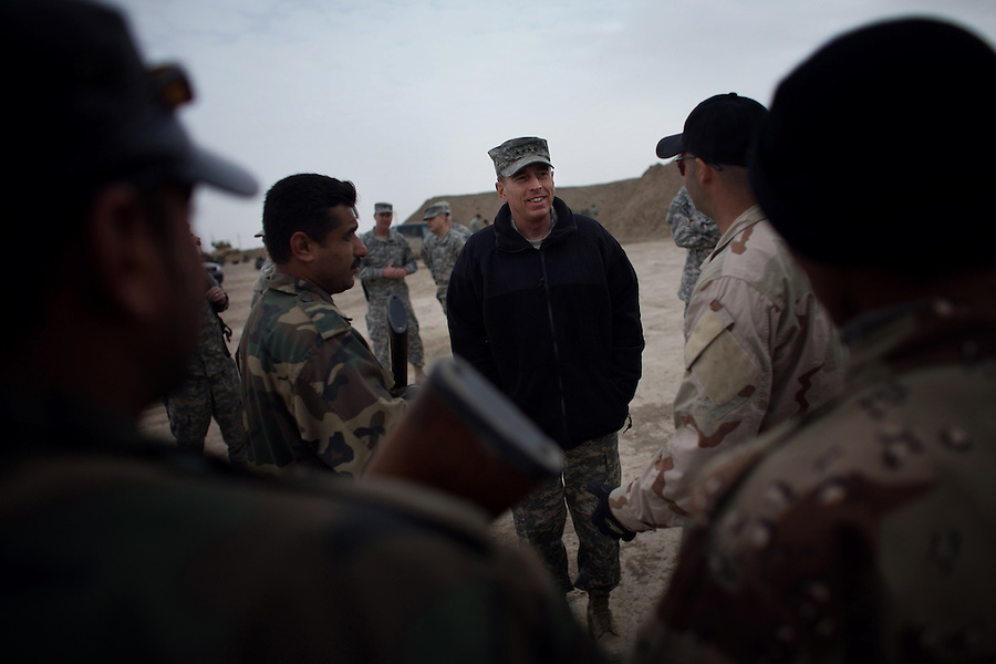 Iraq commander General David Petraeus inspects the work of Army Special Forces soldiers tasked to train potential Iraqi S.W.A.T. police officers at Camp Echo in ad-Diwaniyah. The visit was took place during a visit by Petraeus -   and his immediate subordinate Lt. General ? Odierno - to attend a change of command ceremony for rotating Polish units in ad-Diwaniyah, a majority Shiia city in southern Iraq. The incoming Polish unit will be the last Polish force to serve in Iraq after Warsaw announced plans to withdraw its troops in the fall. The Polish have third largest national contingent serving in Iraq after the US and Great Britain.raq commander General David Petraeus inspects the work of Army Special Forces soldiers tasked to train potential Iraqi S.W.A.T. police officers at Camp Echo in ad-Diwaniyah. The visit was took place during a visit by Petraeus -   and his immediate subordinate Lt. General Raymond Odierno - to attend a change of command ceremony for rotating Polish units in ad-Diwaniyah, a majority Shiia city in southern Iraq. The incoming Polish unit will be the last Polish force to serve in Iraq after Warsaw announced plans to withdraw its troops in the fall. The Polish have third largest national contingent serving in Iraq after the US and Great Britain.