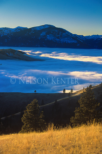 Fog fills the Bitterroot Valley while the sky is clear at higher elevations above Hamilton, Montana