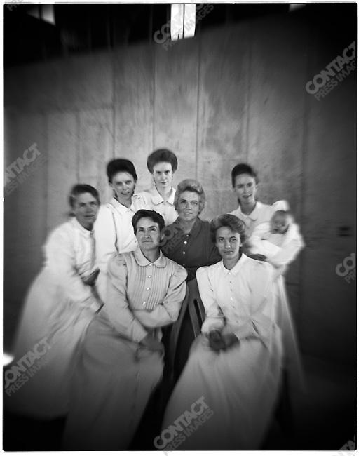 Fundamentalist Mormon group F.L.D.S., a group of mothers: front: Nancy Barlow, Elizabeth Jessop; second row: Zavenda Jessop, Rose Barlow,Dora Mae Barlow, Sandra Steed, Megan Dockstader (holding baby Richard Seth Dockstader). Church compound in Eldorado, Texas, USA, February 12, 2009