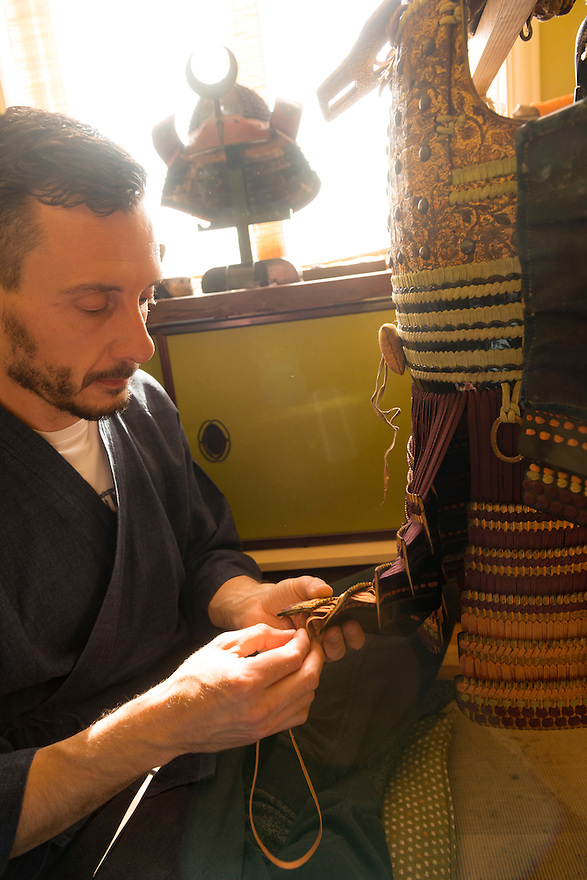 Soanes works on the lacing of a set of armour. Robert Soanes Japanese Armour and Antiques Restorer, Brighton, UK, May 6, 2016. Craftsman Robert Soanes specializes in the restoration and conservation of samurai armour, swords and other Japanese fine art. He lives and works in the English seaside resort of Brighton.