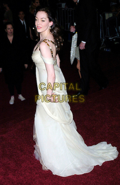 "ROSE McGOWAN .2007 Metropolitan Museum of Art Costume Institute Gala celebrating ""Poiret: King of Fashion"" exibition at the Metropolitan Museum of Art, New York City, New York, USA..May 7th, 2007.full length white cream sheer dress gold straps one shoulder .CAP/ADM/BL.©Bill Lyons/AdMedia/Capital Pictures *** Local Caption ***"