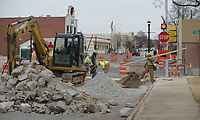 NWA Democrat-Gazette/ANDY SHUPE<br /> Workers construct islands along Emma Avenue Thursday, Dec. 28, 2017, in downtown Springdale. The city of Springdale received a $642,638 grant from the Walton Family Foundation meant to begin implementation of the city's Downtown Master Plan and help fund improvements at nearby Luther George Grove Street Park.