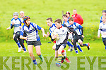 Corca Dhuibhne's Caoilte Curneen tries to get by Tralee Sharks Seamus Harty at O'Dowd park, Tralee on Saturday.