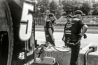 ELKHART LAKE, WI - June 23, 2017: (EDITOR'S NOTE: Photo taken on 35mm black and white film with vintage 35mm rangefinder camera) Pit crew men watch from the pits during practice for the Kohler Grand Prix IndyCar race at Road America on June 23, 2017 in Elkhart Lake, Wisconsin. (Photo by Brian Cleary/BCPix.com)