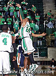 North Texas Mean Green forward Kedrick Hogans (24)) drives in for a basket in the game between the Jackson State Tigers and the University of North Texas Mean Green at the North Texas Coliseum,the Super Pit, in Denton, Texas. UNT defeated Jackson 68 to 49