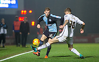 Jason McCarthy of Wycombe Wanderers knocks the ball past Jon Stead of Notts County during the Sky Bet League 2 match between Wycombe Wanderers and Notts County at Adams Park, High Wycombe, England on 15 December 2015. Photo by Andy Rowland.