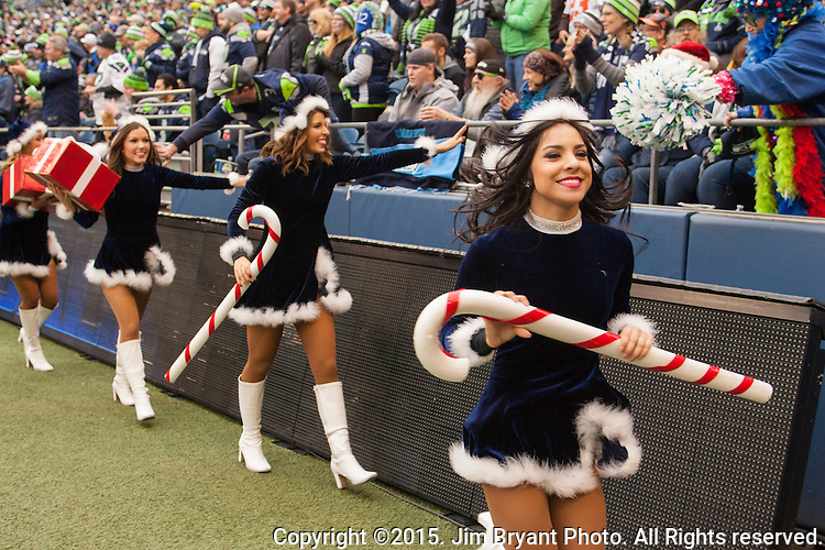 Seattle Seahawks dance team, the Seagals, feet fans during their game against the Cleveland Browns at CenturyLink Field in Seattle, Washington on December 20, 2015. The Seahawks clinched their fourth straight playoff berth in four seasons by beating the Browns 30-13.  ©2015. Jim Bryant Photo. All Rights Reserved.