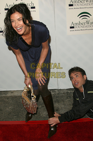 "TERI HATCHER & ANT.""Protecting Kids With Laughter"" AmberWatch Benefit at the Original Improv, Hollywood, California, USA..January 29th, 2007.full length blue dress black boots gold bag purse crawling foot gesture laughing funny.CAP/ADM/BP.©Byron Purvis/AdMedia/Capital Pictures"