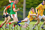 Conor Cox Feale Rangers in action against Gary Sayers Mid Kerry in the First Round of the Kerry Senior Football Championship at O'Rahilly Park Ballylongford on Sunday.
