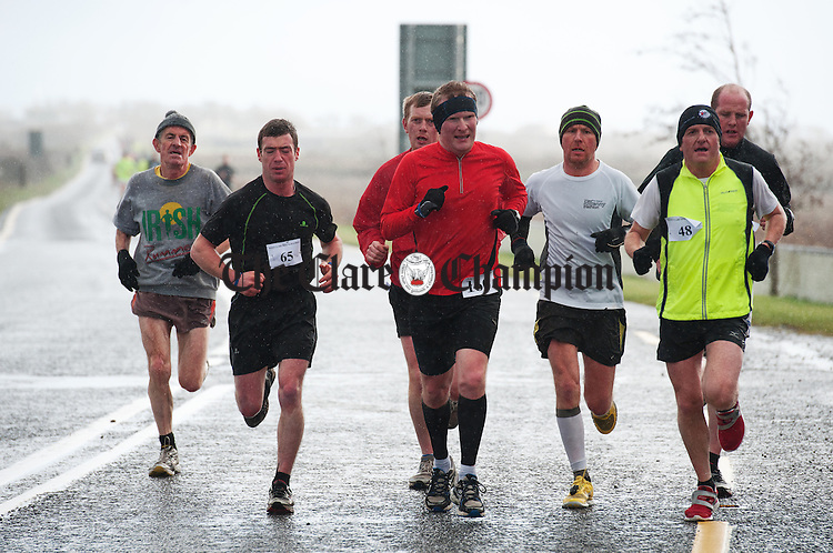 Athletes reach Moyasta Junction during the West Clare Mini marathon which ran from Kilrush to  Kilkee in aid of the West Clare Mini Marathon Cancer Centre. Photograph by John Kelly.