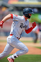 Reading Fightin Phils center fielder Cord Sandberg (34) runs to first base during the second game of a doubleheader against the Portland Sea Dogs on May 15, 2018 at FirstEnergy Stadium in Reading, Pennsylvania.  Reading defeated Portland 9-8.  (Mike Janes/Four Seam Images)