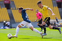 Auckland's David Browne beats Wellington Phoenix's Noah Tipene-Clegg  during the ISPS Handa Premiership football match between Wellington Phoenix Reserves and Auckland City FC at Westpac Stadium in Wellington, New Zealand on Saturday, 23 November 2019. Photo: Dave Lintott / lintottphoto.co.nz
