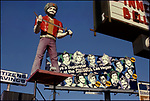 Statue for Ali Baba's nightclub at La Brea and Sunset Blvd. with Sahara Las Vegas billboard and Citizens Savings bank sign in background circa 1977.