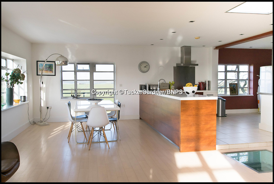 BNPS.co.uk (01202 558833)<br /> Pic: TuckerGardner/BNPS<br /> <br /> Stylish open plan interior.<br /> <br /> Potential buyers are scrambling to view a unique RAF control tower that has appeared on the property radar near Saffron Walden in Essex.<br /> <br /> A Second World War tower has been transformed into a stylish family home and is now on the market for £775,000.<br /> <br /> Little Walden airfield in Essex was opened in 1944 and the base was home to American Mustang fighters and B17 Flying Fortresses throughout the war.<br /> <br /> It is now a four-bedroom home with a wrap-around balcony and access to the rooftop to make the most of the panoramic views of the surrounding open countryside.<br /> <br /> Although in its secluded rural location the only flypast your likely to see nowadays is of the feathered variety.