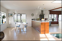 BNPS.co.uk (01202 558833)<br /> Pic: TuckerGardner/BNPS<br /> <br /> Stylish open plan interior.<br /> <br /> Potential buyers are scrambling to view a unique RAF control tower that has appeared on the property radar near Saffron Walden in Essex.<br /> <br /> A Second World War tower has been transformed into a stylish family home and is now on the market for &pound;775,000.<br /> <br /> Little Walden airfield in Essex was opened in 1944 and the base was home to American Mustang fighters and B17 Flying Fortresses throughout the war.<br /> <br /> It is now a four-bedroom home with a wrap-around balcony and access to the rooftop to make the most of the panoramic views of the surrounding open countryside.<br /> <br /> Although in its secluded rural location the only flypast your likely to see nowadays is of the feathered variety.