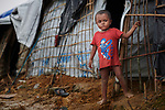 From the front of his family's shelter, a Rohingya refugee boy surveys the sprawling Kutupalong Refugee Camp near Cox's Bazar, Bangladesh. More than 600,000 Rohingya have fled government-sanctioned violence in Myanmar for safety in Bangladesh.