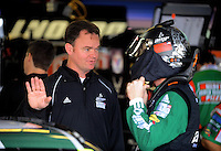 Oct. 30, 2009; Talladega, AL, USA; NASCAR Sprint Cup Series driver Dale Earnhardt Jr (right) with crew chief Lance McGrew during practice for the Amp Energy 500 at the Talladega Superspeedway. Mandatory Credit: Mark J. Rebilas-
