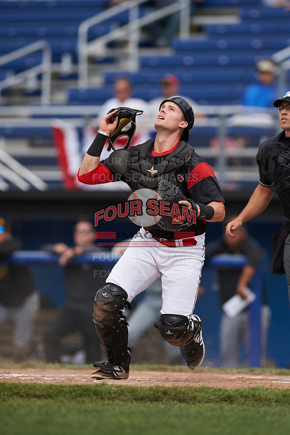 Batavia Muckdogs catcher Alex Jones (43) tracks a foul ball popup during a game against the West Virginia Black Bears on June 25, 2017 at Dwyer Stadium in Batavia, New York.  Batavia defeated West Virginia 4-1 in nine innings of a scheduled seven inning game.  (Mike Janes/Four Seam Images)