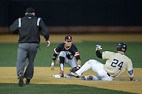 Gavin Sheets (24) of the Wake Forest Demon Deacons is tagged out at second base by Davidson Wildcats shortstop Max Bazin (21) at David F. Couch Ballpark on February 28, 2017 in Winston-Salem, North Carolina.  The Demon Deacons defeated the Wildcats 13-5.  (Brian Westerholt/Four Seam Images)