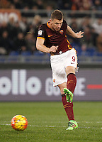 Calcio, Serie A: Roma vs Frosinone. Roma, stadio Olimpico, 30 gennaio 2016.<br /> Roma&rsquo;s Edin Dzeko kicks the ball during the Italian Serie A football match between Roma and Frosinone at Rome's Olympic stadium, 30 January 2016.<br /> UPDATE IMAGES PRESS/Isabella Bonotto