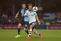 Goal scorer Alex Kacaniklic of Fulham and Michael Harriman of Wycombe Wanderers keep eyes on the ball during the Capital One Cup match between Wycombe Wanderers and Fulham at Adams Park, High Wycombe, England on 11 August 2015. Photo by Andy Rowland.