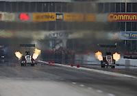 Apr. 26, 2013; Baytown, TX, USA: NHRA top fuel dragster driver Bob Vandergriff Jr (left) races alongside Spencer Massey during qualifying for the Spring Nationals at Royal Purple Raceway. Mandatory Credit: Mark J. Rebilas-