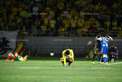(R-L) Takumi Yamada, Norihiro Yamagishi (Montedio),<br /> DECEMBER 7, 2014 - Football / Soccer :<br /> JEF United Chiba players look dejected as Takumi Yamada and Norihiro Yamagishi of Montedio Yamagata celebrate their promotion to Division 1 after the 2014 J.League Road to J1 Play-offs Final match between JEF United Ichihara Chiba 0-1 Montedio Yamagata at Ajinomoto Stadium in Tokyo, Japan. (Photo by Kenzaburo Matsuoka/AFLO)