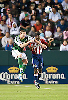 CARSON, CA – June 3, 2011: Portland Timbers forward Kenny Cooper (33) heads ball away from Chivas USA defender Michael Lahoud (11) during the match between Chivas USA and Portland Timbers at the Home Depot Center in Carson, California. Final score Chivas USA 1, Portland Timbers 0.