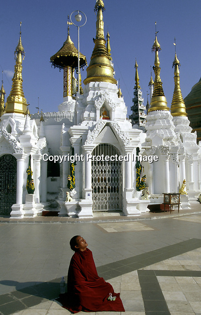 A monk praying at Pagoda on December 22, 1996 in central Rangoon (Yangon) , Burma. The country is ruled by a military government who took power after they annuled democratic elections in 1988..(Photo: Per-Anders Pettersson/ Liaison Agency)
