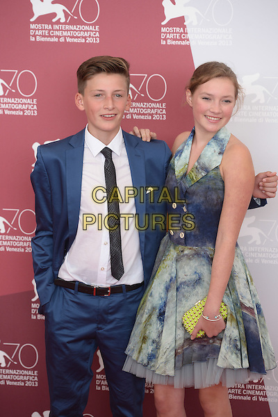 Levin Liam, Helena Phil<br /> 'Wolfskinder' Photocall during the 70th Venice International Film Festival, Venice, Italy.<br /> August 29th, 2013<br /> half length white suit tie shirt blue dress yellow clutch bag tie dye<br /> CAP/ZZG<br /> &copy;ZZG/Capital Pictures