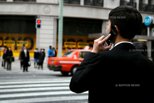 A Japanese businessman uses a flip-phone on the street in Ginza shopping district on February 17, 2015, Tokyo, Japan. According to data from MM Research Institute Flip-phones sales increased for first time in seven years in Japan in 2014. In Japan flip-phones monthly rates are cheaper in comparison to smartphones which are more expensive than in other countries. Flip-phones sales rose 5.7% in 2014 whilst smartphone sales declined 5.3%. (Photo by Rodrigo Reyes Marin/AFLO)