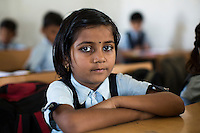 Anjali Kanel, aged 6, studies in class in the Vasudha Vidya Vihar school in Khargone, Madhya Pradesh, India on 12 November 2014. Anjali is the daughter of a Fairtrade Cotton Producer and her ambition is to be a Computer Engineer. Fairtrade farmers get a 5% discount on school fees because the school was built using the Fairtrade Premium. Photo by Suzanne Lee for Fairtrade