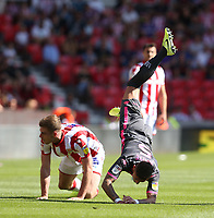 Leeds United's Ben White is tackled by Stoke City's Liam Lindsay<br /> <br /> Photographer Stephen White/CameraSport<br /> <br /> The Premier League - Stoke City v Leeds United - Saturday August 24th 2019 - bet365 Stadium - Stoke-on-Trent<br /> <br /> World Copyright © 2019 CameraSport. All rights reserved. 43 Linden Ave. Countesthorpe. Leicester. England. LE8 5PG - Tel: +44 (0) 116 277 4147 - admin@camerasport.com - www.camerasport.com
