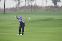 Cao Yi (CHN) plays his 2nd shot on the 14th hole during Friday's Round 2 of the 2014 BMW Masters held at Lake Malaren, Shanghai, China 31st October 2014.<br /> Picture: Eoin Clarke www.golffile.ie