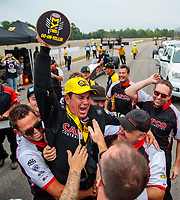 Aug 19, 2018; Brainerd, MN, USA; NHRA top fuel driver Billy Torrence celebrates with crew after winning the Lucas Oil Nationals at Brainerd International Raceway. Mandatory Credit: Mark J. Rebilas-USA TODAY Sports