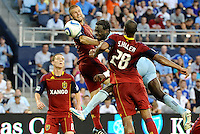 Sporting KC midfielder Kei Kamara (pale blue) gets between Real Salt Lake defenders for the header on goal... Sporting Kansas City defeated Real Salt Lake 2-0 at LIVESTRONG Sporting Park, Kansas City, Kansas.