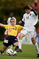 The Fire's Craig Capano and Joselito Vaca of the MetroStars go for the ball. The MetroStars defeated the Chicago Fire 2-0 during an exhibition game on Monday October 11, 2004 at At-A-Glance Field at the National Soccer Hall of Fame and Museum, Oneonta, NY..