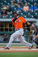 L.J. Hoes (28) of the Norfolk Tides follows through on his swing against the Charlotte Knights at BB&T BallPark on April 20, 2016 in Charlotte, North Carolina.  The Knights defeated the Tides 6-3.  (Brian Westerholt/Four Seam Images)
