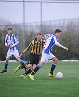 VOETBAL: HEERENVEEN: 23-11-2014, Sportpark Skoatterwâld, VV Heerenveen - Frisia, uitslag 2 - 0, Geoffrey Schilte (#18), Remco Hof, (#4), ©foto Martin de Jong