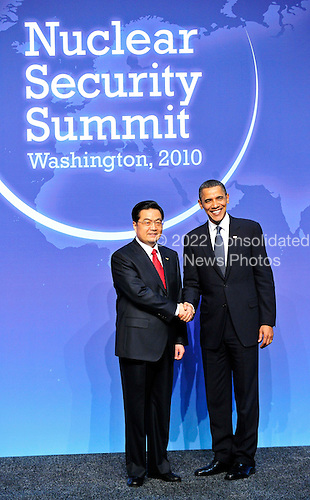 United States President Barack Obama welcomes President Hu Jintao of China to  the Nuclear Security Summit at the Washington Convention Center, Monday, April 12, 2010 in Washington, DC. .Credit: Ron Sachs / Pool via CNP