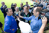 USA head coach Bruce Arena gives an interview after training in Hamburg, Germany, for the 2006 World Cup, June, 6, 2006.