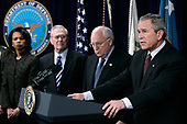 "Arlington, VA - January 4, 2006 -- United States President George W. Bush speaks, calling 2005 a ""year of progress"" in Iraq, as (left to right) Secretary of State Condoleezza Rice, Secretary of Defense Donald Rumsfeld and Vice President Dick Cheney look on January 4, 2006 at the Pentagon in Arlington, Virginia. Bush was at the Pentagon for a briefing on the war by top commanders. He also offered condolences to the families of the 12 West Virginia miners who were found dead after a frantic rescue effort following an explosion at the Sago mine January 2, 2006. <br /> Credit: Alex Wong - Pool via CNP"