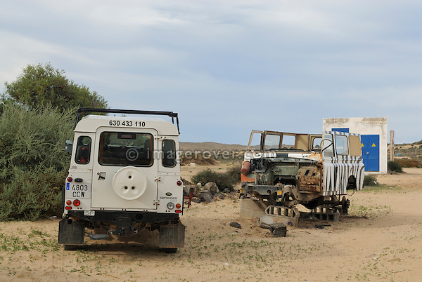 Spain, Canary Islands, Archipielago Chinijo, Isla Graciosa, Caleta del Sebo. Old and new - new Land Rover Defender and old Santana donor vehicle. --- No releases available. Automotive trademarks are the property of the trademark holder, authorization may be needed for some uses.